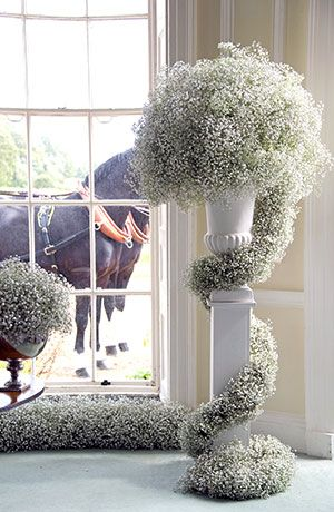 Baby's breath pillar décor. Would be gorgeous for a winter wedding. Include some mini lights in white or other appropriate color. And wow! <3 <3 <3                                                                                                                                                      More