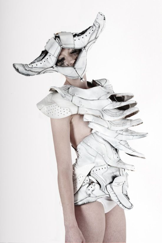 Five Hungarian design students from the Moholy-Nagy University of Art and Design collaborated on a collection made by re-using leather belts and shoes Alluding to creatures of ancient Greek mythology and science fiction themes, the recycled leather was given new life by the white paint yet still retains the quality of the worn leather beneath.