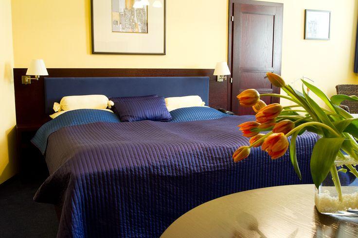 Manželská postel v pokoji DeLuxe