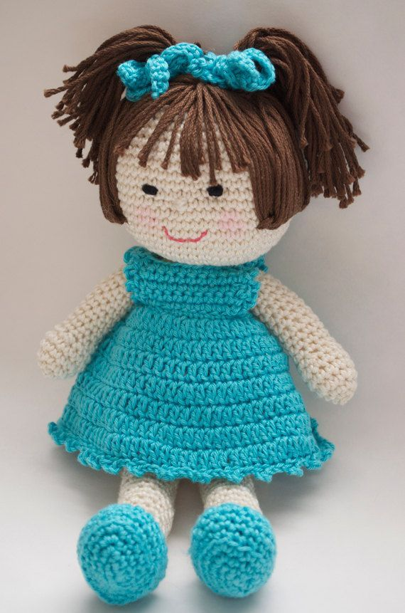 Doll Crochet Pattern Meet Marcy! The first in my series of adorable crochet doll patterns. Make her for yourself or for a special girl!  Pattern includes detail instructions on how to make doll, construct and style her hair, how to position her eyes, nose and mouth for that perfect sweet look. PLUS instructions for her dress, panties, shoes and hair bows. Materials Needed: - DK Weight Cotton Yarn (Michaels carries a great brand--details given) - Crochet Hook Size B - Fiberfill - Tapestry…