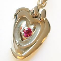 Symbolic of parents looking over and protecting their child. The stone was chosen as the birthstone of the daughter. Celebrate a special anniversary with this pendant. Make your own starting at $200