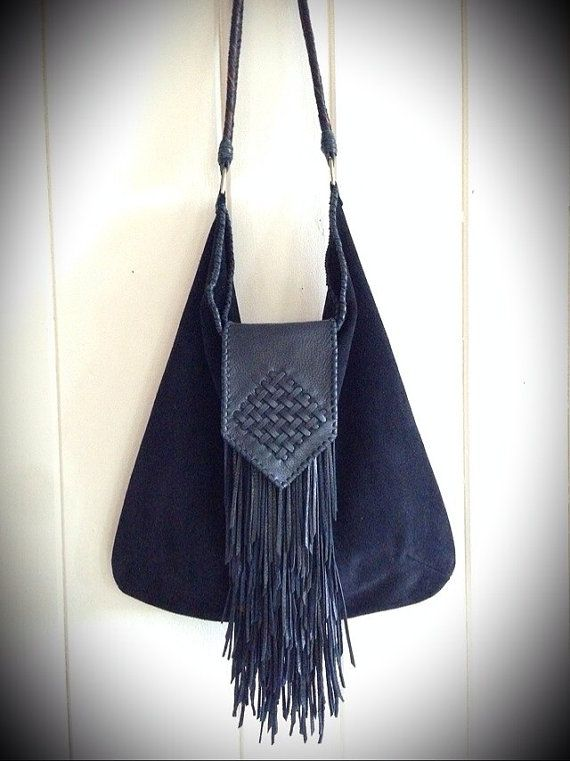 One of a kind black suede leather fringe tote style handbag with hand-stitched edges and decorative woven flap. Fishtail braided horse hair strap