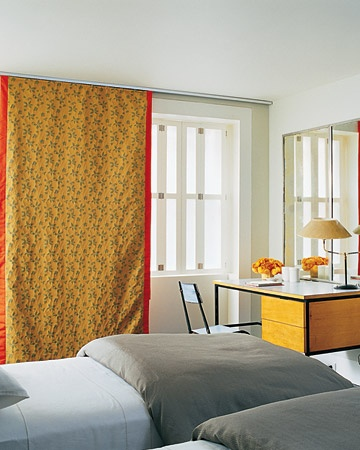 Felt-lined curtain panels serve as a wall hanging, plus block out light and street noise.