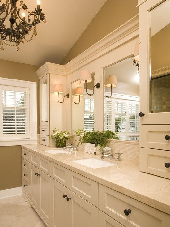 Traditional Bathroom Design, Pictures, Remodel, Decor and Ideas The cabinets lighten the room and give it a spa feel. I also like the tiles above the counters! I would expand them around the mirrors instead of the wood trim.