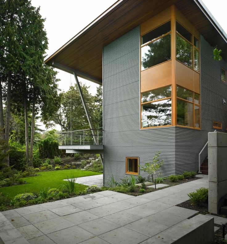 Wrap around window. Metal-clad siding on addition. Leschi Residence by Adams Mohler Ghillino Architects | HomeDSGN