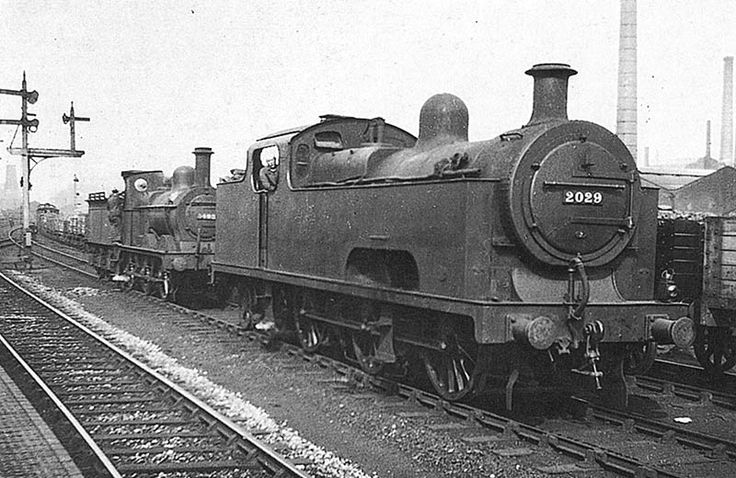 """""""Ex-Midland Railway 0-6-4T 'Flatiron' No 2029 and ex-MR 2F 0-6-0 No 3492 are seen standing on the down goods line alongside Saltley station in 30th Aug 1930. Built by Derby works in July 1907, No 2029 was a member of a class never considered successful although it remained in service until it was withdrawn from Saltley shed in January 1937. """" (from Warwickshire Railways)"""