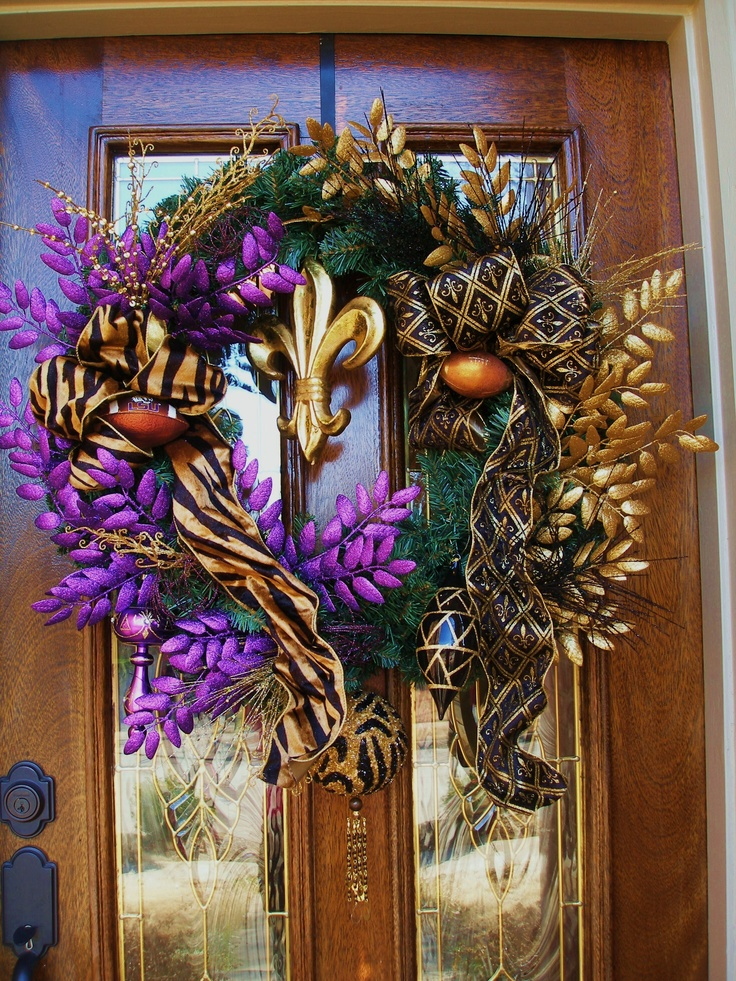 """One of my sister-n-law's made this wreath.   I use it for Mardi Gras but its really an LSU / Saints wreath.   I should add a small sign on it that says, """"Who Dat at my door?""""  :)"""