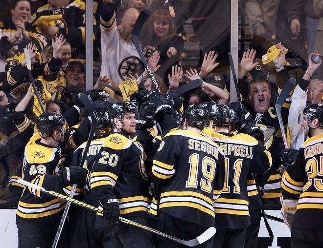 Boston celebrates winning Game 1 in OT against Washington on 4/12/12