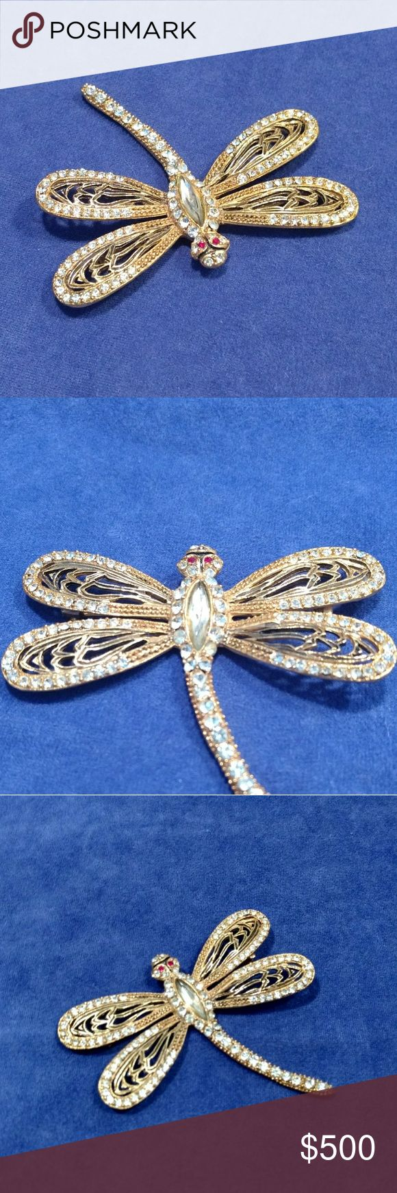 Rare, Gorgeous Vintage Dragonfly Brooch Gorgeous Vintage Dragonfly Brooch. Covered in stones, exquisite in detail and design. The pin is from the '50s or '60's and is in excellent condition. All rhinestones in tact. Vintage Jewelry Brooches