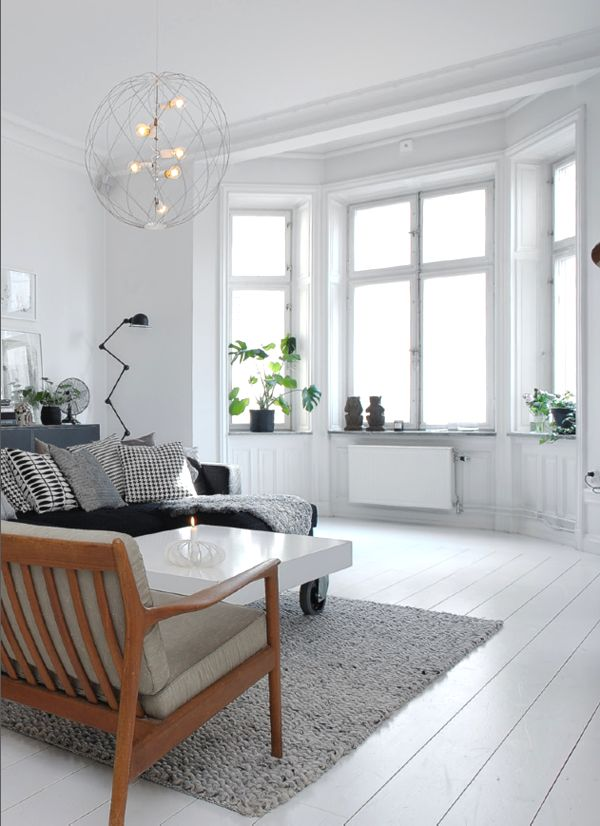 Living room- love this feeling. Blue/grey paint, neutrals and wood floors (though ours won't be painted white!).