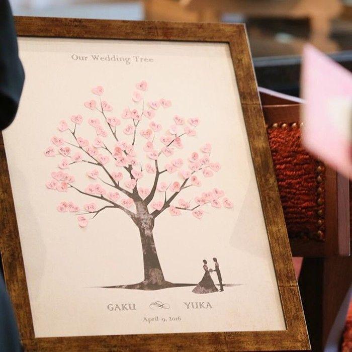 ゲストの方がピンクのハートをつけていくことで桜の木が満開になるというウェディングツリー♡春らしい素敵なウェディングツリーが出来上がりました*