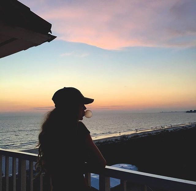 This would be me standing the balcony of my beach house. My BF would come out and hug me from behind.