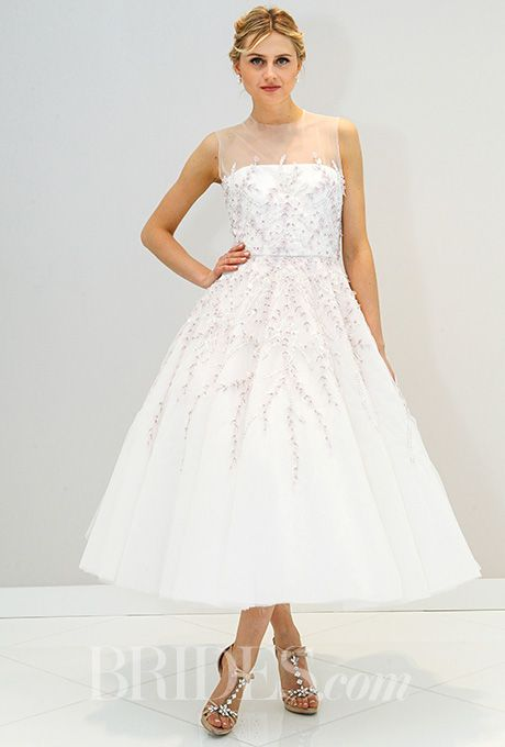 A modern, ethereal tea-length wedding dress by @randirahm | Brides.com