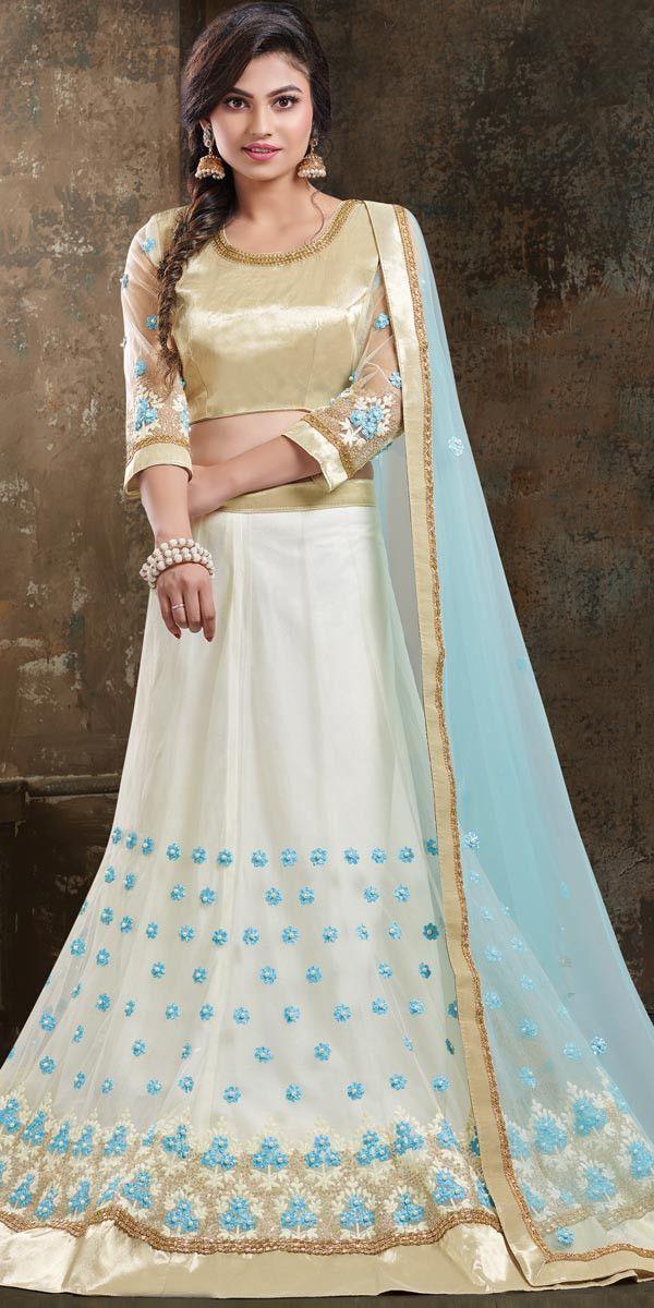 9d7744b7ae7 Ravishing Off-White Net Lehenga Choli.         lehenga  lehengas   weddingwear  bridalwear  partywear  partywearlehenga  indianwedding   desiwedding  bride ...