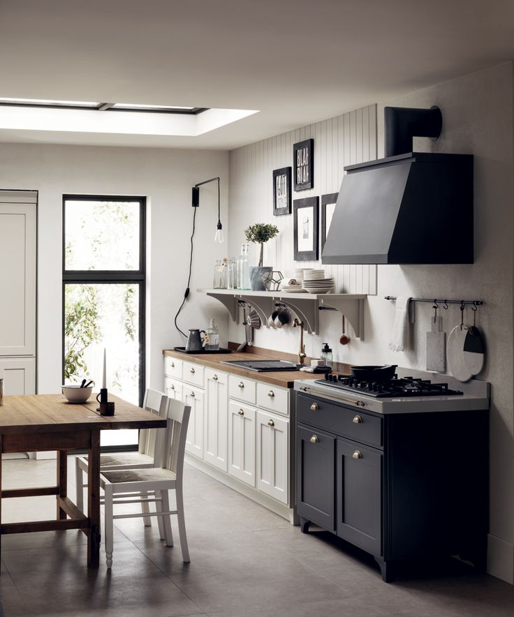 The undisputed star of this setting is the new Favilla cooking block in cast iron effect matt lacquer, with a Pearl Quartz worktop and a load-bearing foot. Shabby chic kitchen ideas.