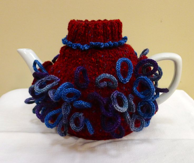 Sock style tea cosy with lots and lots of knitted loops