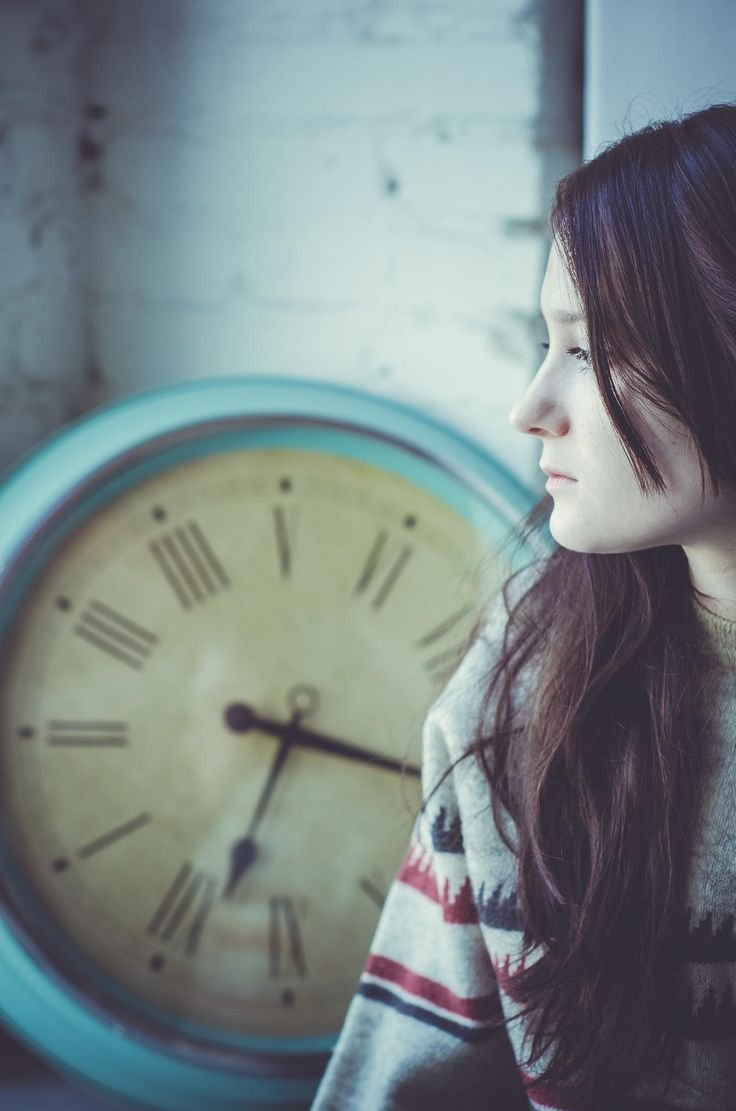 The girl - Girl next to the clock at the window