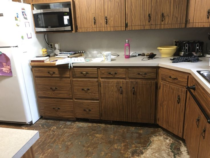 Water damage to kitchen cabinets and sub floor damage. in ...