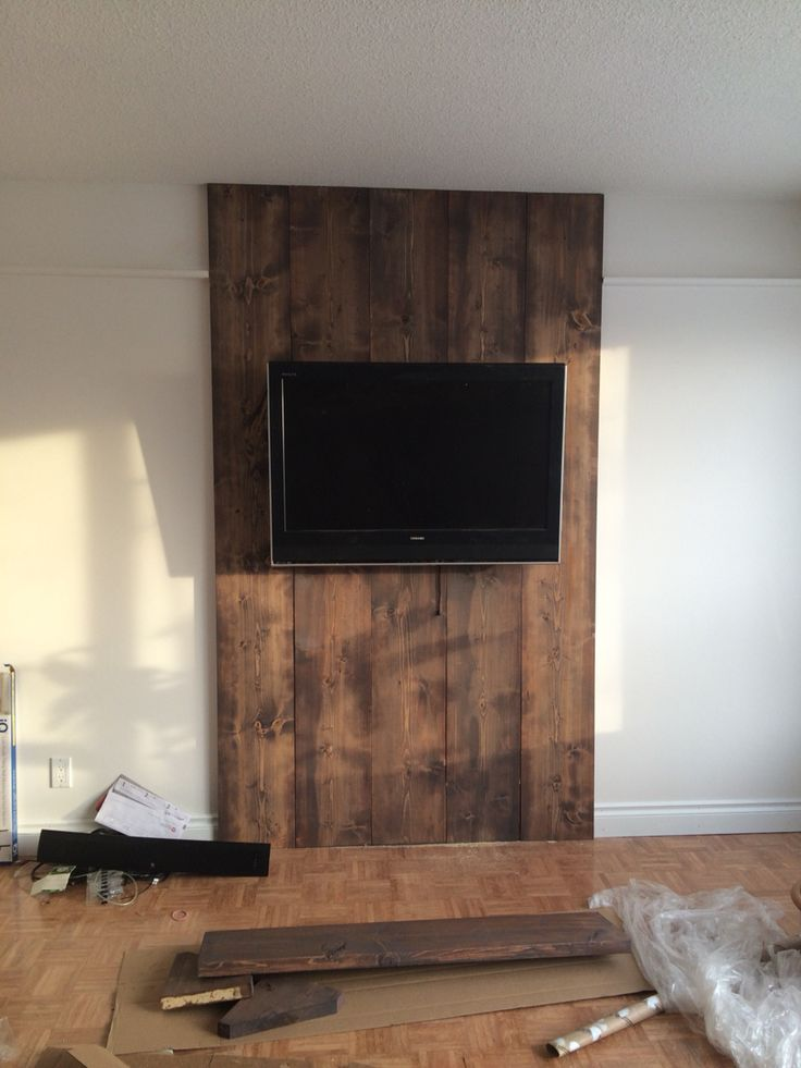 Wood wall, 1x12 stained floor color and grey wash to antique it! Hidden wires! Love it!
