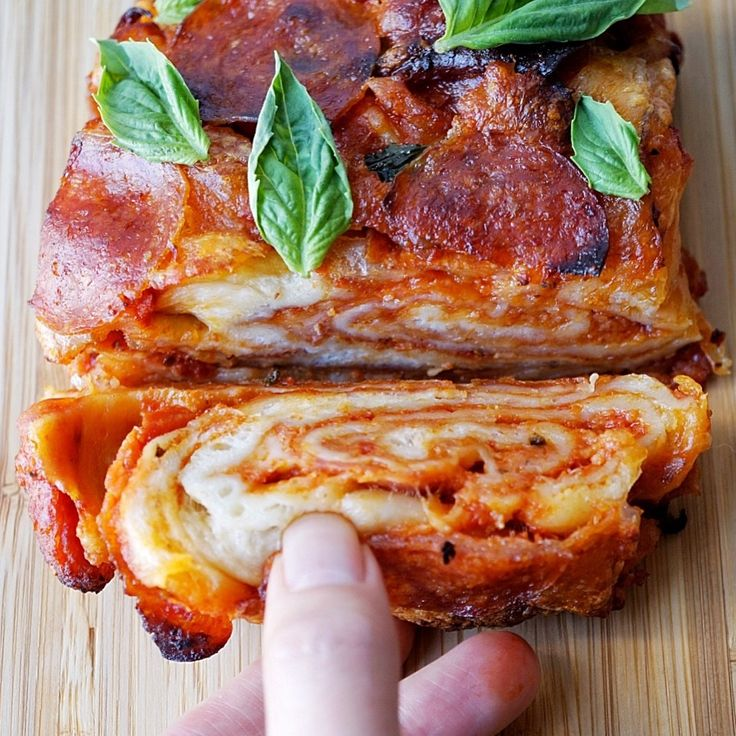 Swirled layers of pizza bread and cheese… …Just some simple ingredients and you'll have the most amazing piece of art!   I was inspired by the beautiful layers and textures o…