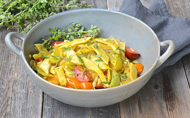 <p>In this recipe, olive oil, garlic, and fresh heirloom tomatoes are the simplest of flavors, yet they enhance the tender Italian flat beans in a way that tastes like magic.</p>