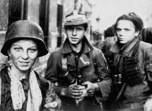 """Jerzy Tomaszewski - WW2 Warsaw Uprising Polish Boy Soldiers Tadeusz Rajszczak (""""Maszynka"""") (wearing the helmet) and two other young soldiers from Batalion Miotła, 2 September 1944."""