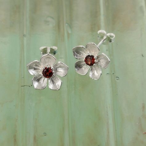 Garnet Posy Earrings £29.00 Rich deep red garnet stones set in a pretty flower stud earring All of our silver jewellery comes beautifully packaged in our new Christin Ranger branded boxes.