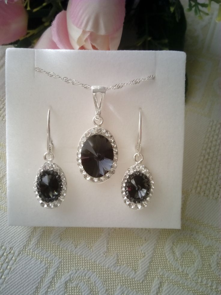 Sterling silver jewelry set with Swarovski crystals in Ceralun construction.