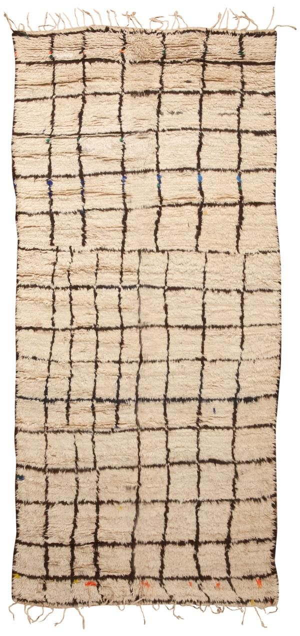 #45354 - Vintage Moroccan Rug, Morocco, Mid 20th Century - This exceptionally modern rug features a well-organized allover pattern arranged over a precise graph. Intersecting avenues and abruptly ending cul de sacs create an abstract allover pattern that decorates the sumptuous beige field of this modern Moroccan rug. Colorful flecks of orange, yellow and blue add to the abstract charm of this minimalist rug from…