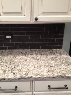 Beautiful Cambria Countertops With Dark Tile Backsplash In A Subway Pattern.