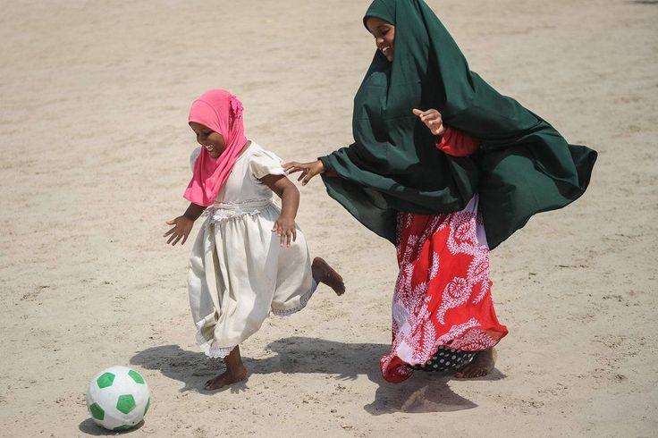 Somali girls play football on the Lido beach in Mogadishu, on January 12, 2018.