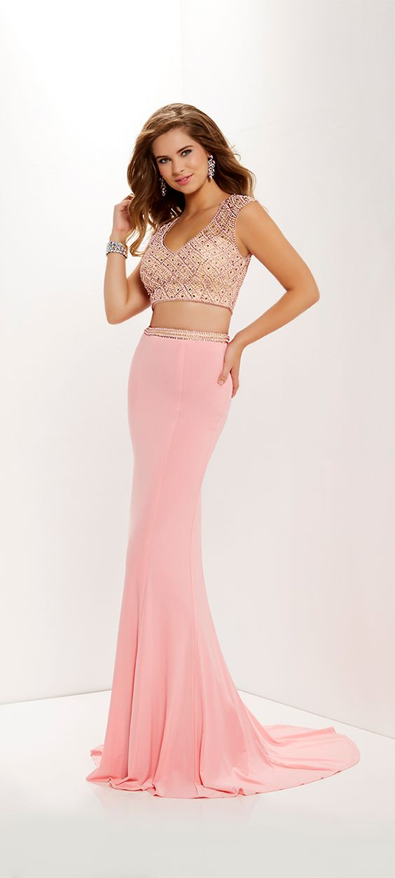 SPRING 2018 // Style 12661 | 		 Elegant with a spicy flare, this two-piece gown has a bodice of nude illusion tulle smothered in contrasting rhinestones and beads, and a trumpet skirt of contrasting jersey finished by a sweep train. #Studio17 #prom2k18 #promdresses #prom18