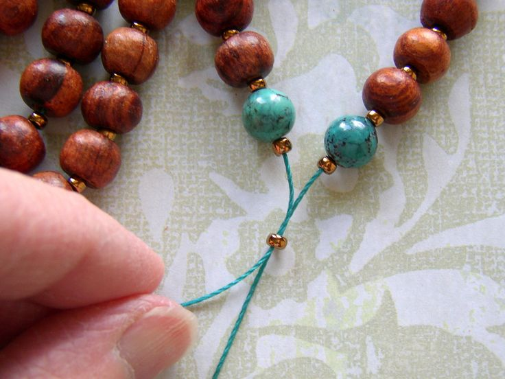 Turn the string of beads into a Mala necklace by bringing the ends together.