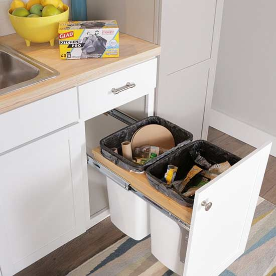 Put trash in its place with a handy built-in cabinet.