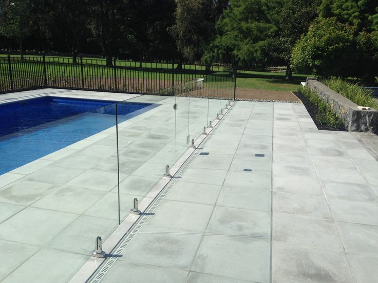 Slot drainage around pool, glass pool fencing