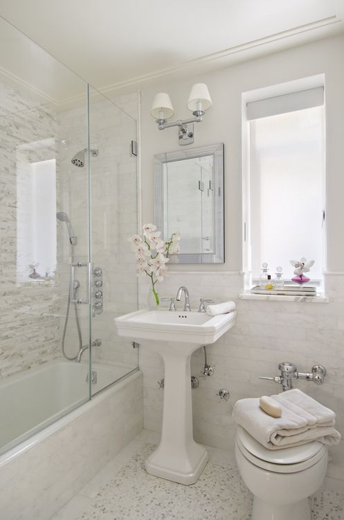texture of same color bathrooms mirrored tray glossy white pedestal sink beveled mirror double sconce seamless glass shower mosaic stacked linear shower