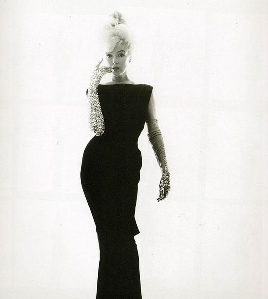 Marilyn, silhouette... no need to show skin -- she was the sexiest of the sexy, even in a classicly simple dress