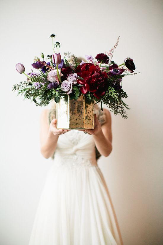 Lavender, green, and cranberry floral arrangement