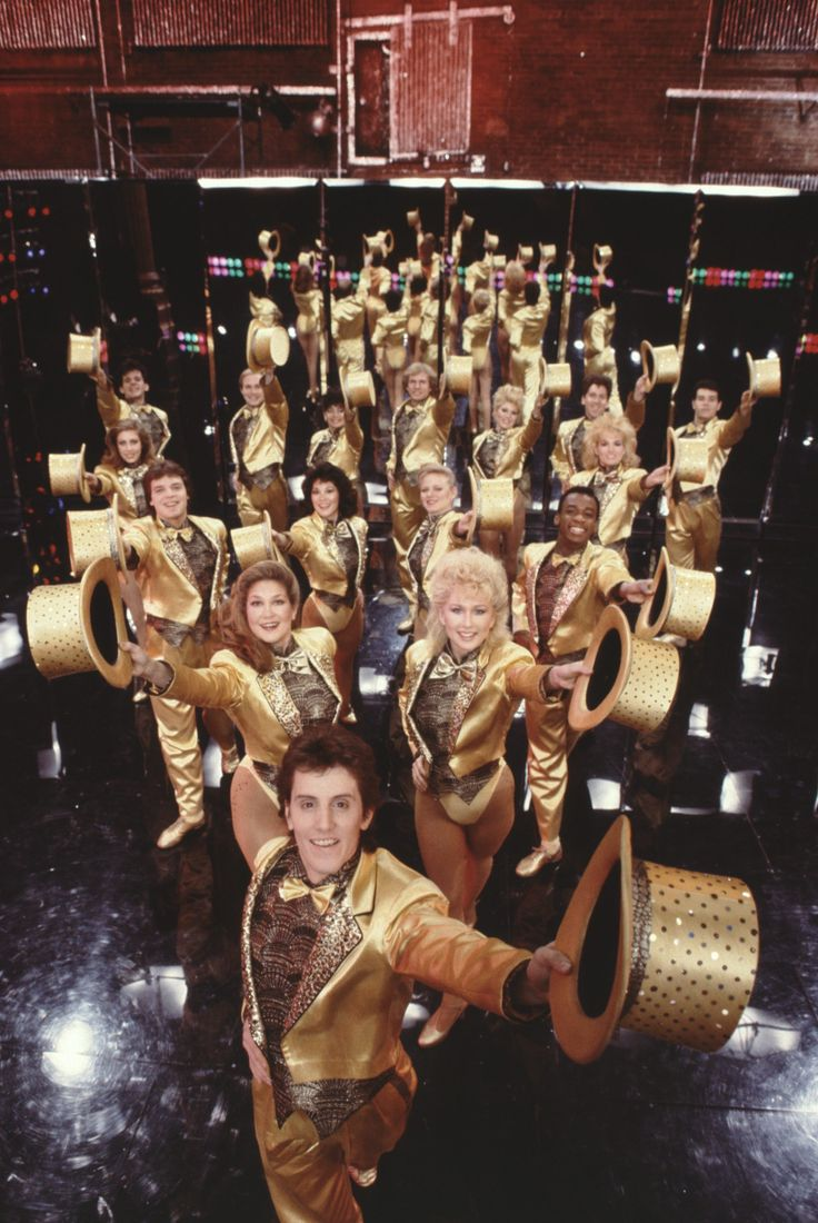 The cast of A Chorus Line takes a picture on stage.   - ELLE.com
