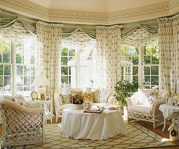 Go Over the Top:   Big bay or bow windows create a room within a room, so make it a special habitat. A bevy of curtain panels and swags festoon this garden-style space. The overabundance creates a free-spirited splendor that could overwhelm a regular room.
