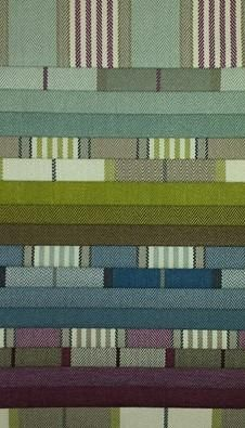 The Douglas Collection is our latest upholstery fabric added to our collection. It is a beautiful range of checks and stripes with a herringbone effect running through it. It comes in fantastic colourways of Blues, Greens, Purples and Beiges. It does 35,000 rubs and is very suitable for the home.