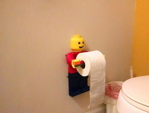 Latest addition to my kids bathroom. The roller is glued together Lego bricks.…