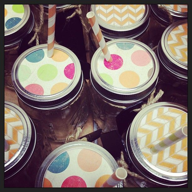 Ball jars with straws & paper toppers :) Perfect for a party!