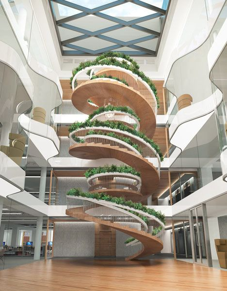 The spiral staircase serves as a connection between the floors, giving people a feeling of unity. This specific image also has plants on the edges of the stairs and a skylight, so it makes the space look brighter and more alive.