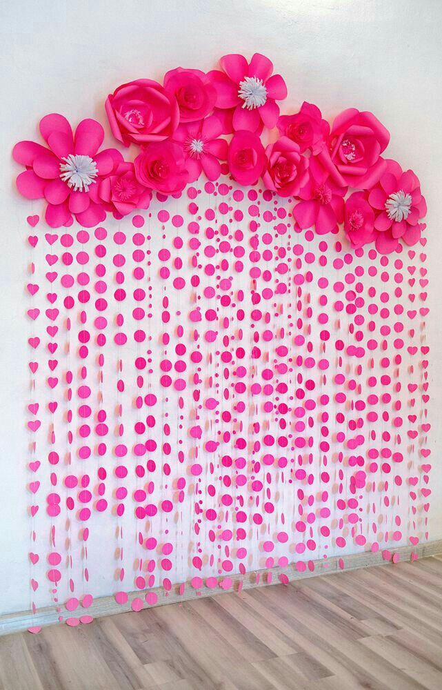 Create a stunning backdrop with paper circles, twine, and large paper flowers
