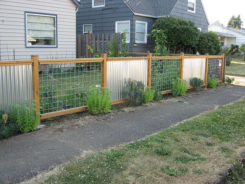 corrugated sheet metal fence but do horizontal wood instead of hog fence