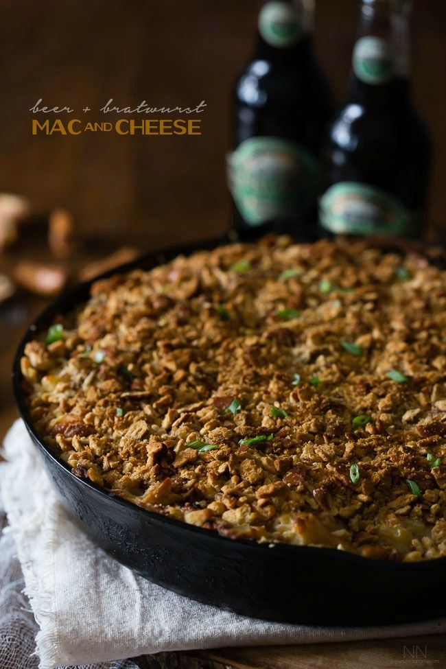 This super flavorful beer bratwurst macaroni and cheese is packed full of stringy cheese, beer, bratwurst and sprinkled with a crunchy pretzel topping. Perfect for Super Bowl Sunday!