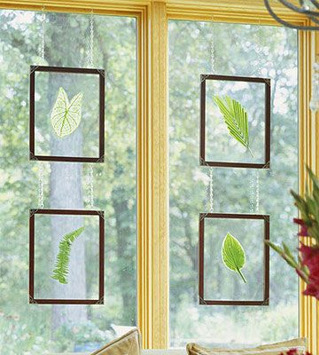 Pluck single leaves, then sandwich them between framed panels of glass. (You can find the frames at crafts stores.) Cup hooks screw inconspicuously to the window trim, and the frames dangle from eye hooks via thin chains. DIY Tip: Swap out the leaves every few weeks when they begin to brown. For a long-lasting display, use dried leaves coated with acrylic artist's spray to prevent discoloration.