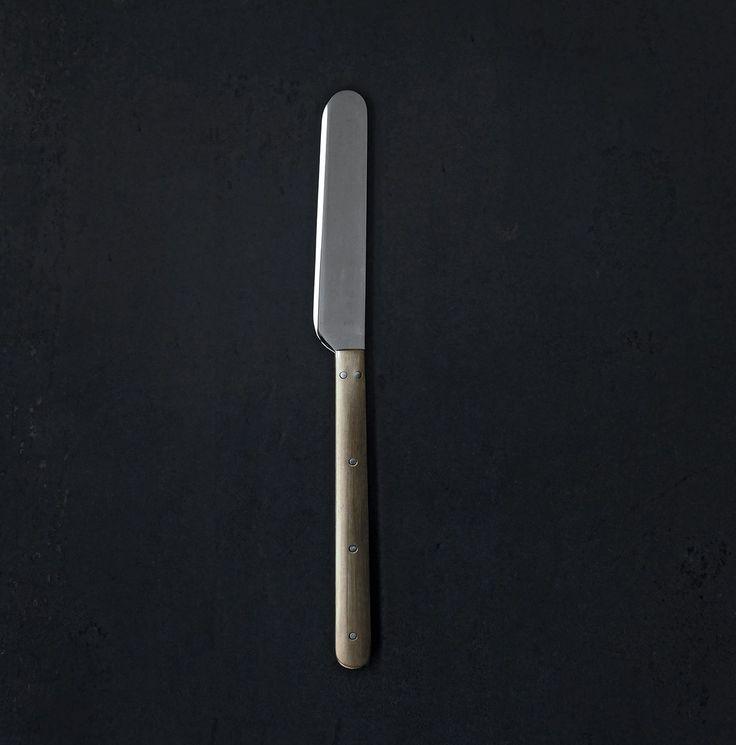 Delectable brass handled butter knife -  Azmaya