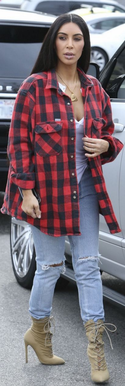 Who made  Kim Kardashian's red plaid shirt, white top, gold jewelry, and tan lace up boots?